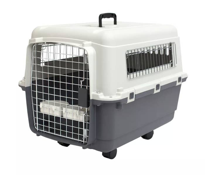 The white and gray two-toned pet crate on wheels
