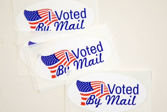 """""""I Voted By Mail"""" stickers with American Flags on them"""