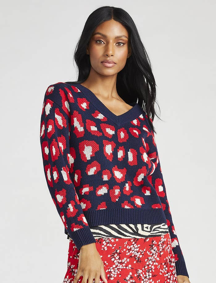 model wearing a blue and red leopard print sweater