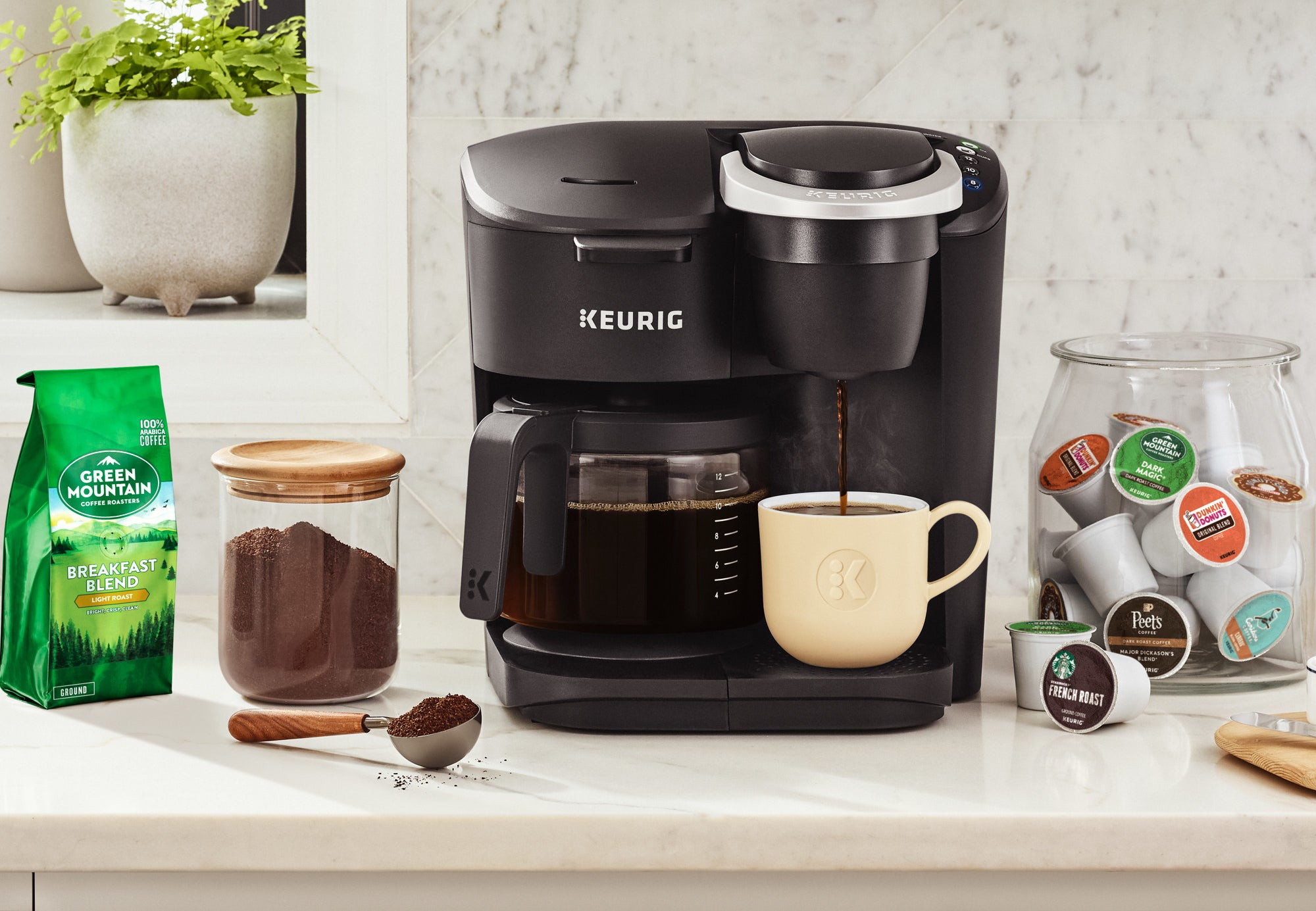 the black keurig coffee maker with k cup pouring and coffee maker brewing