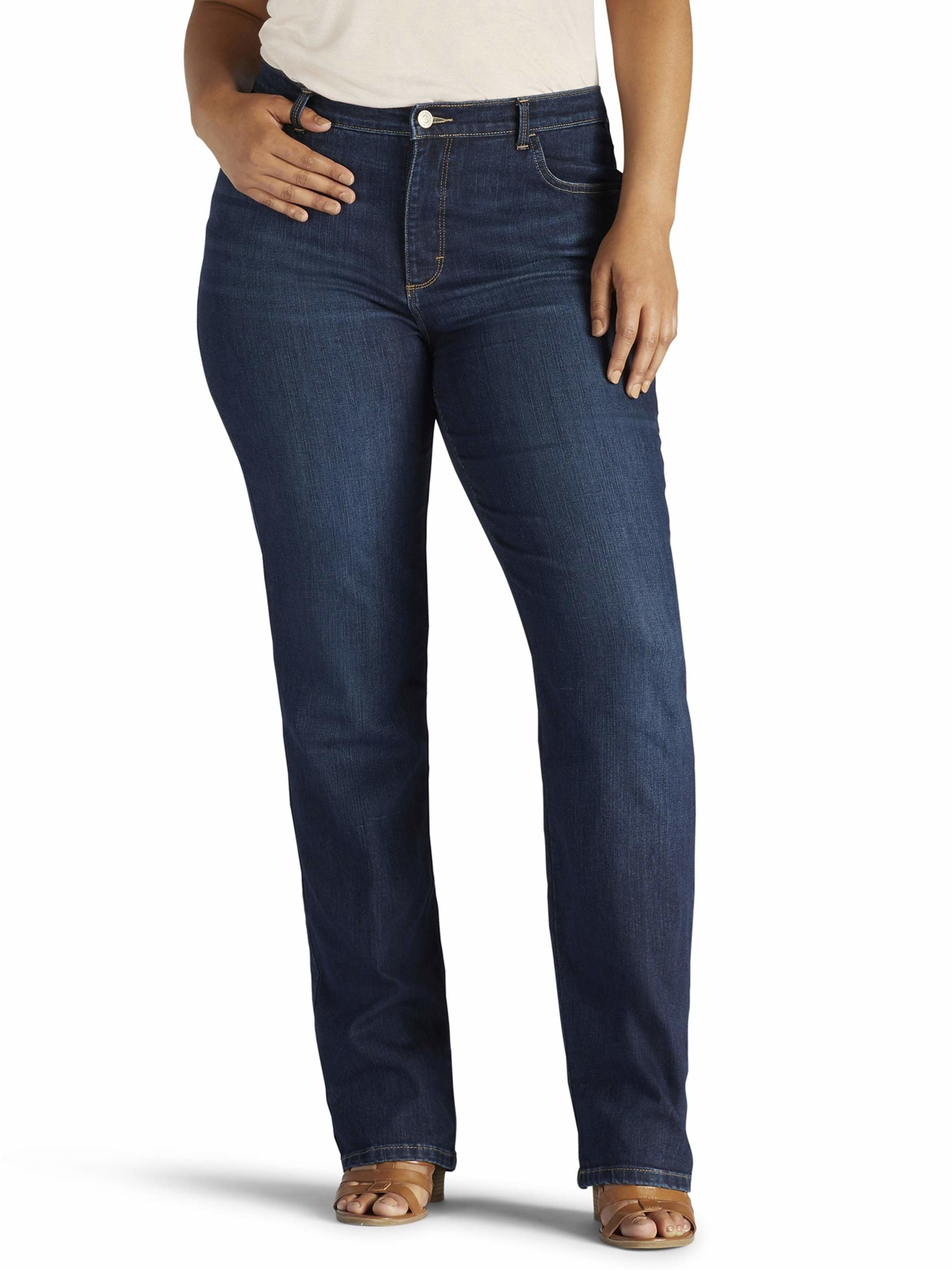 model wearing dark blue jeans with hand in their pocket