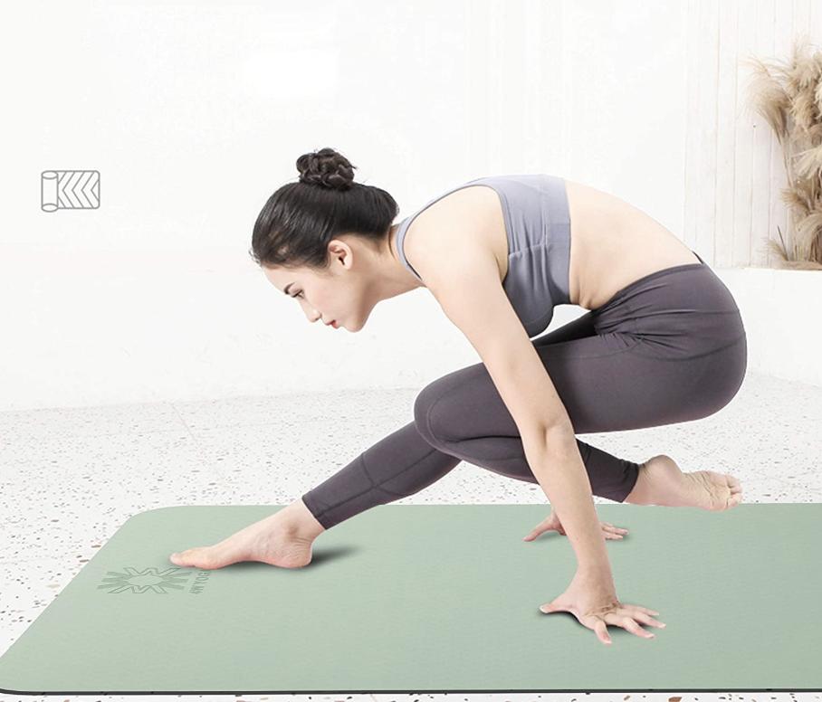 Model on a green yoga mat