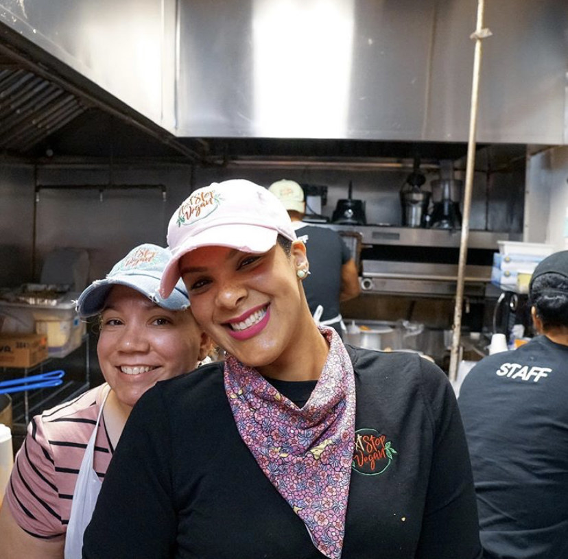 Blenlly (Owner) and Ana (Executive Chef) smiling at their Next Stop Vegan location