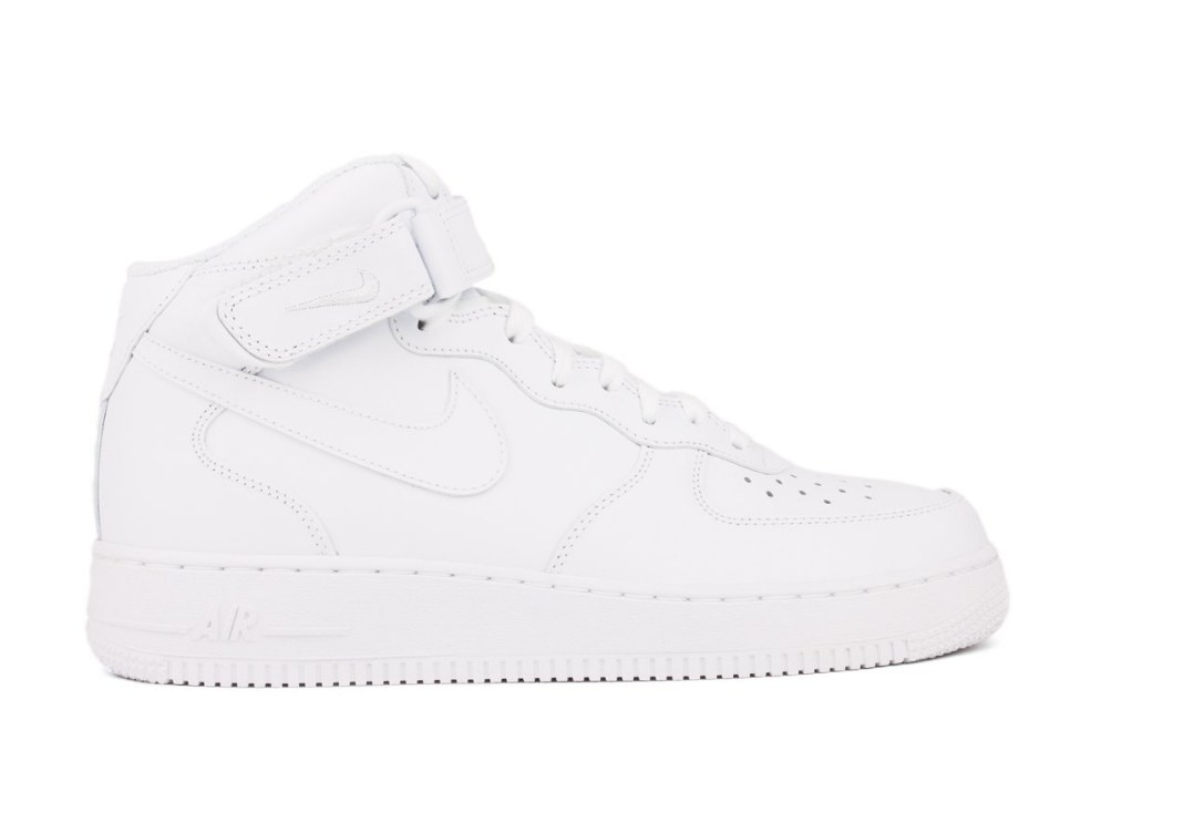 White sneakers with Nike logo and mid-ankle strap