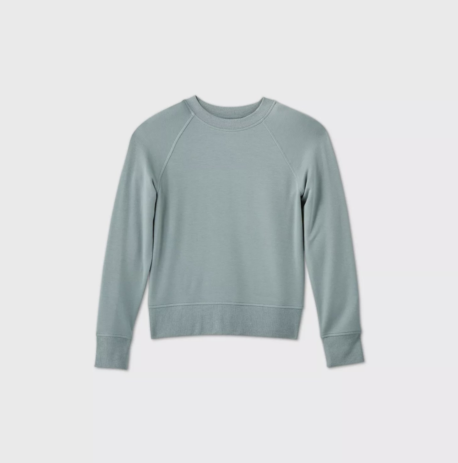 A light blue crew-neck pullover sweater