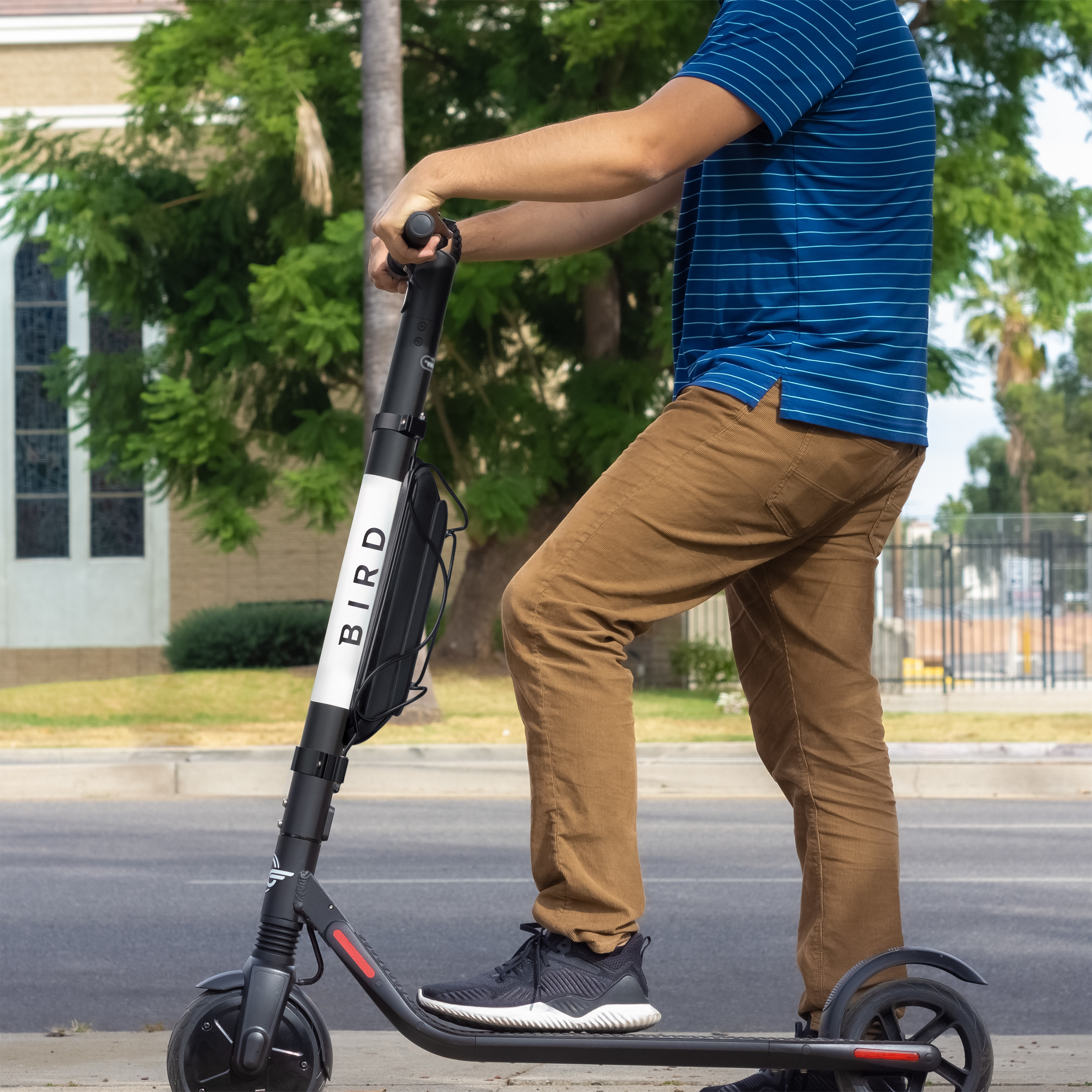 person riding the black electric scooter
