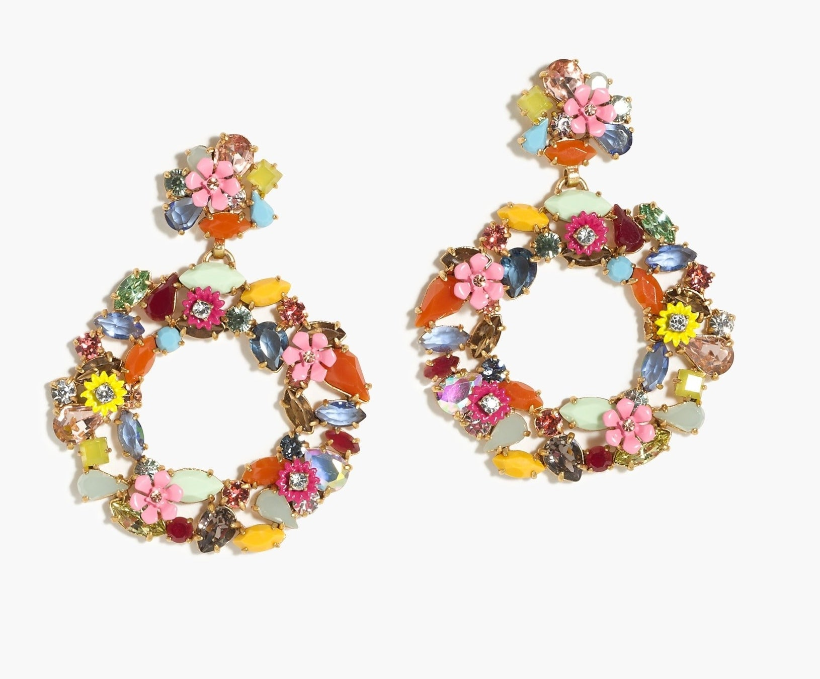 The earrings featuring colorful stones and gems