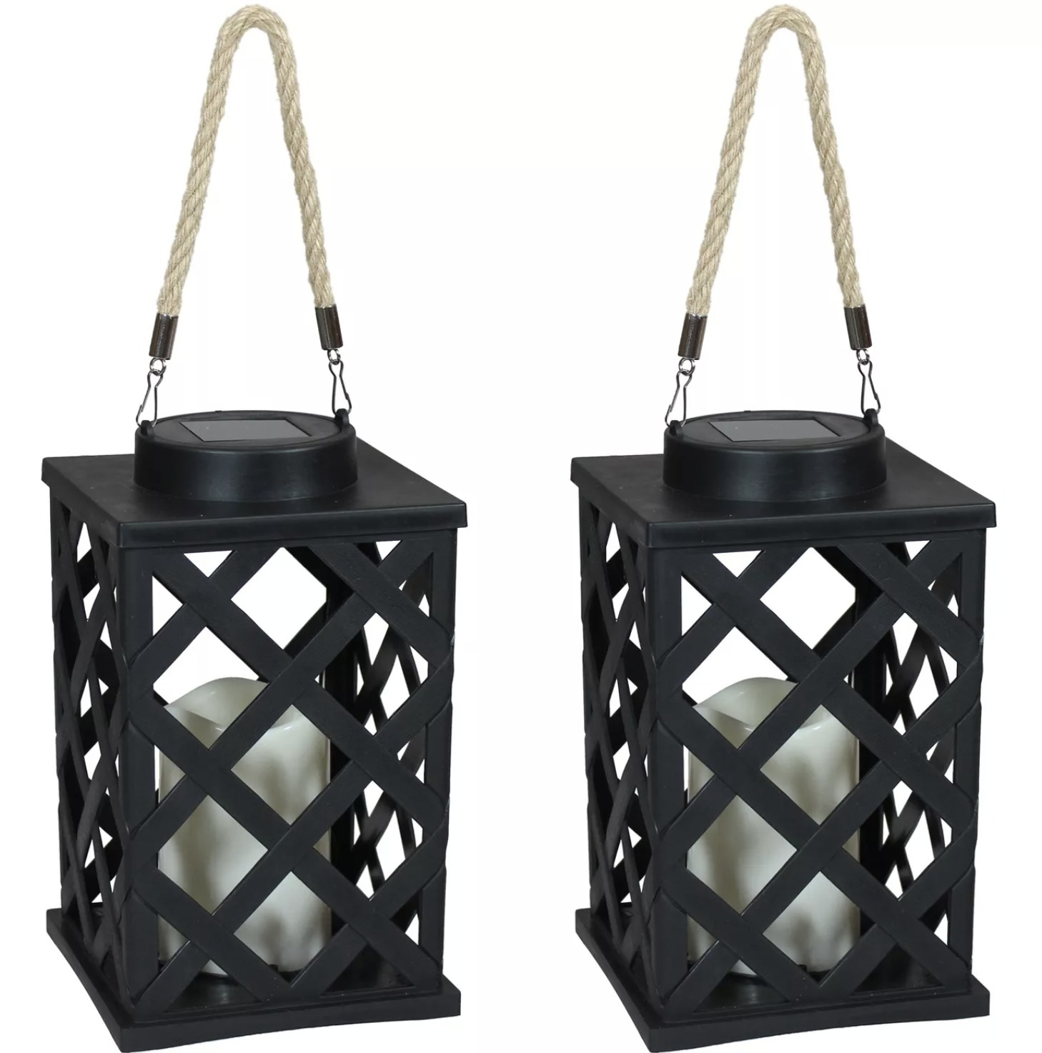 Two black solar-powered LED lanterns with candles inside and ropes attached to hang