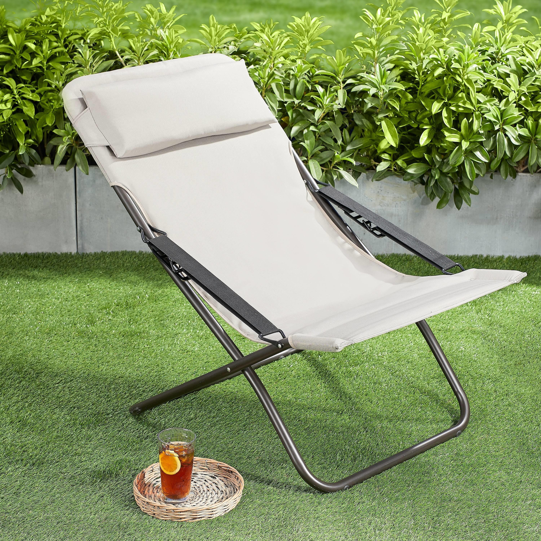 tan folding lawn chair