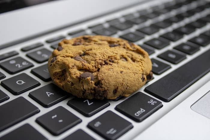 Chocolate chip cookie on a laptop keyboard