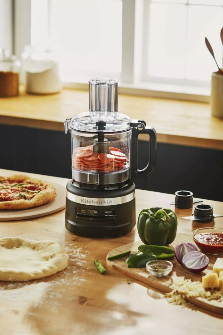 The food processor being used to make sauce for pizza