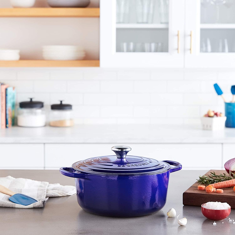 Blue Le Creuset Dutch oven on kitchen counter