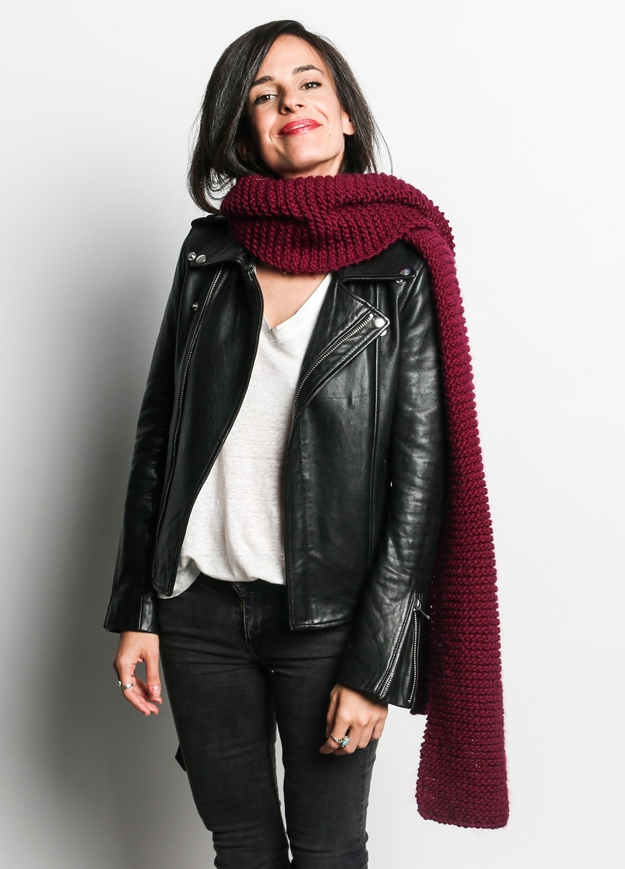 model wears long knit scarf