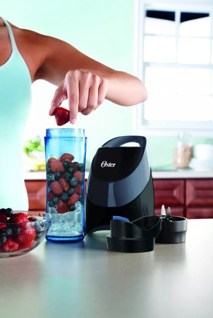 The blender holding berries and ice for a smoothie