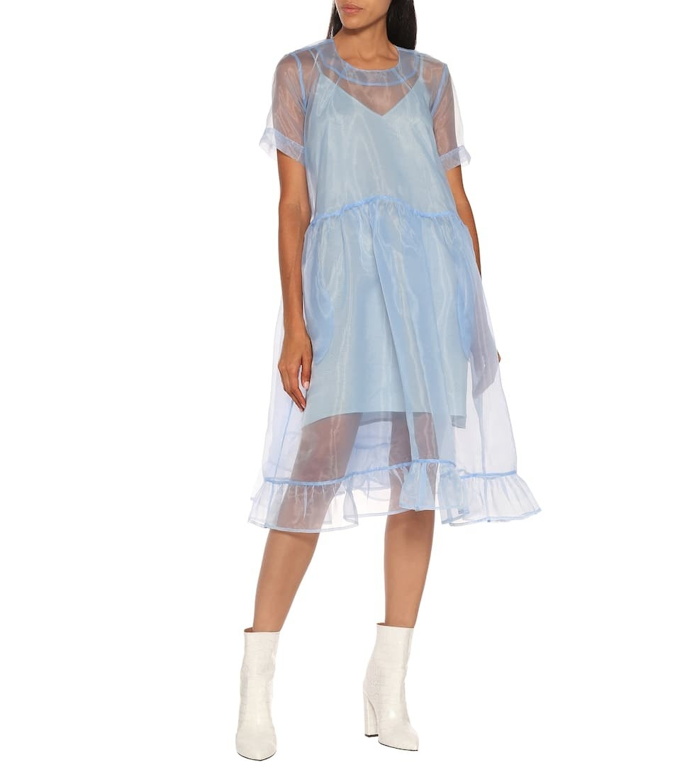a model in the light blue dress which has relaxed T-shirt silhouette with a gathered skirt and a flounced hem