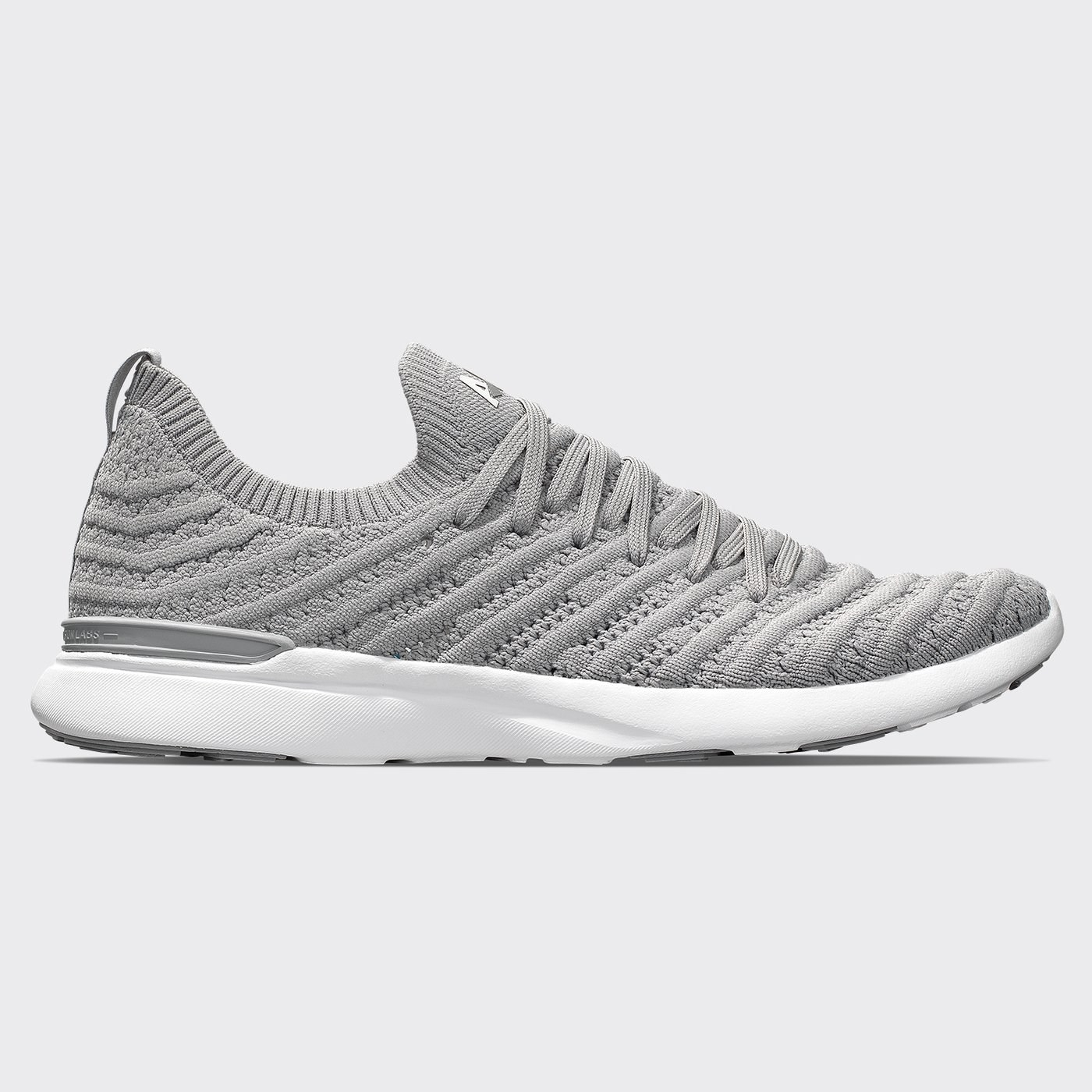 The knit sneaker in grey with grey laces and a white sole