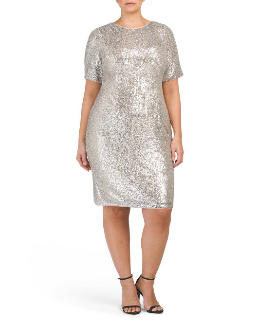 a model in a form fitting t-shirt styled dress covered in silver sequins