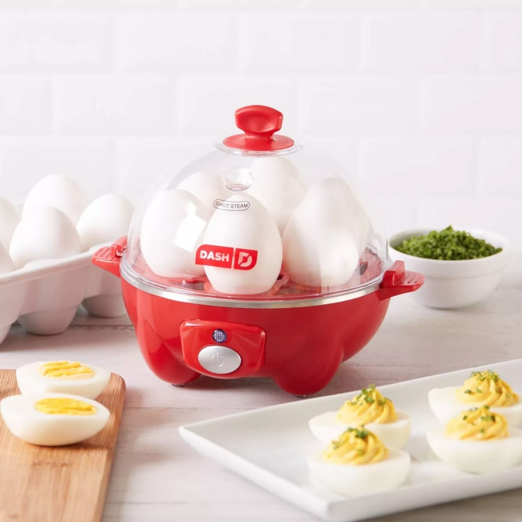 The egg maker being used to make deviled eggs