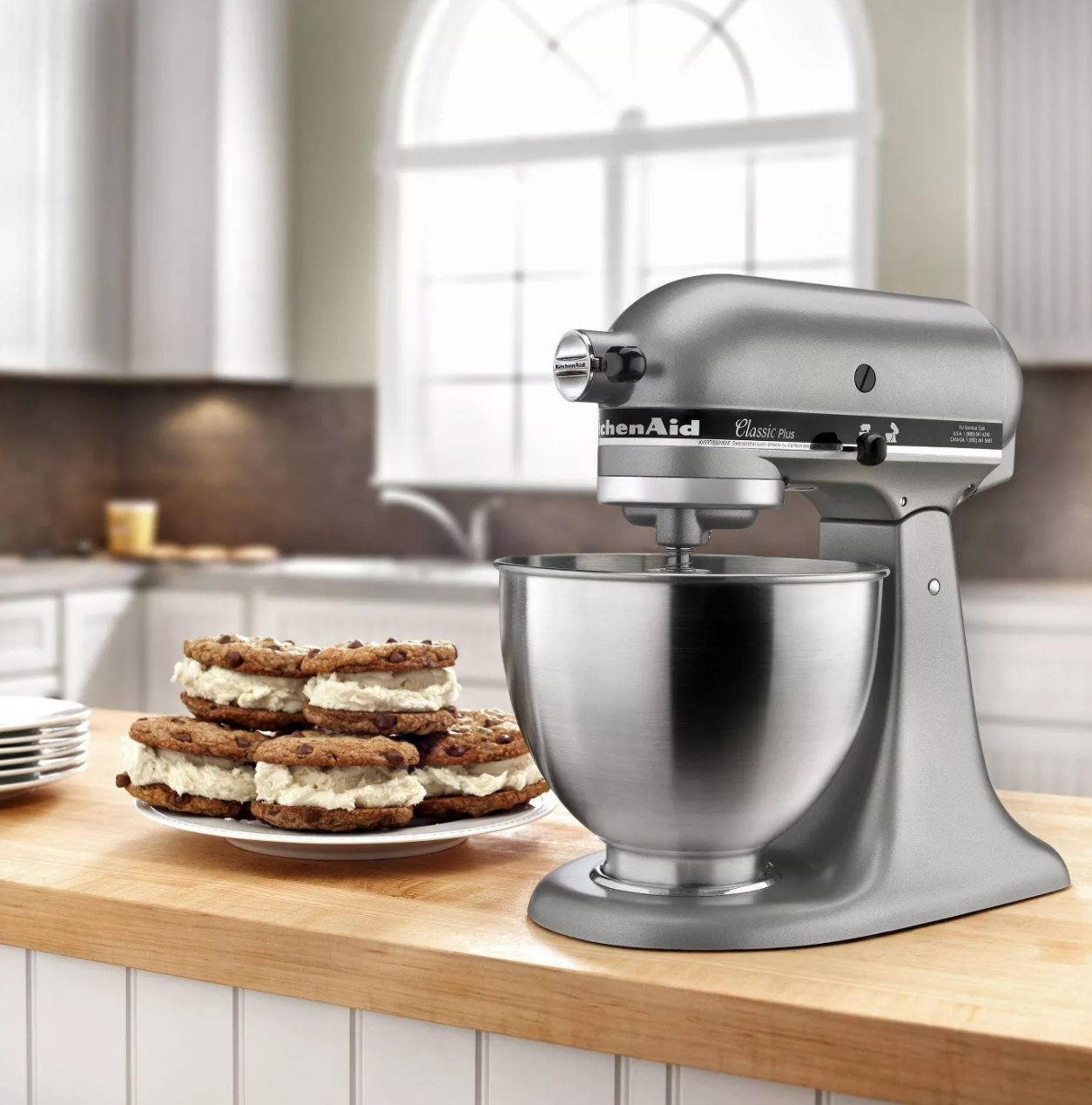 The stainless steel mixer being used to mix the ingredients for cookie sandwiches