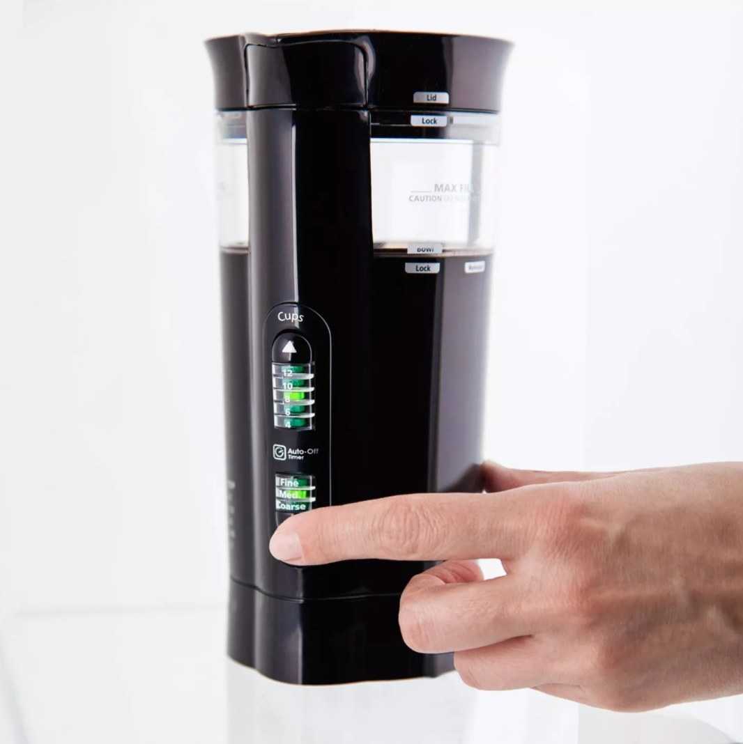 The coffee grinder in someone's hand