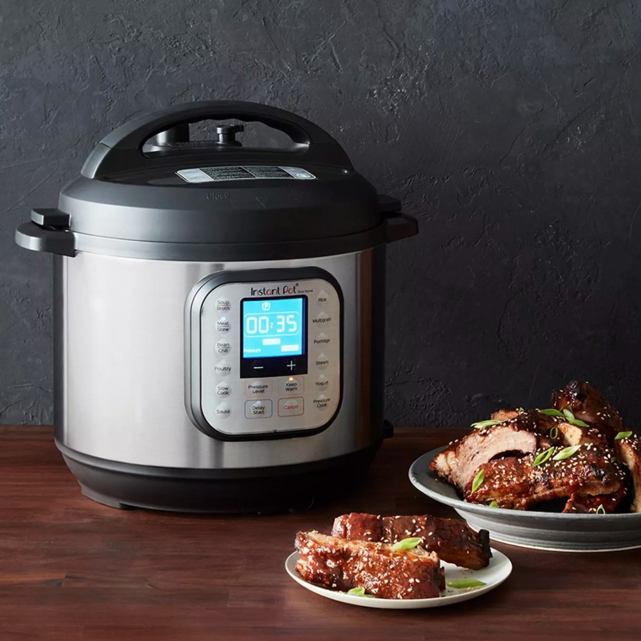 The instant pot being used to make sesame chicken
