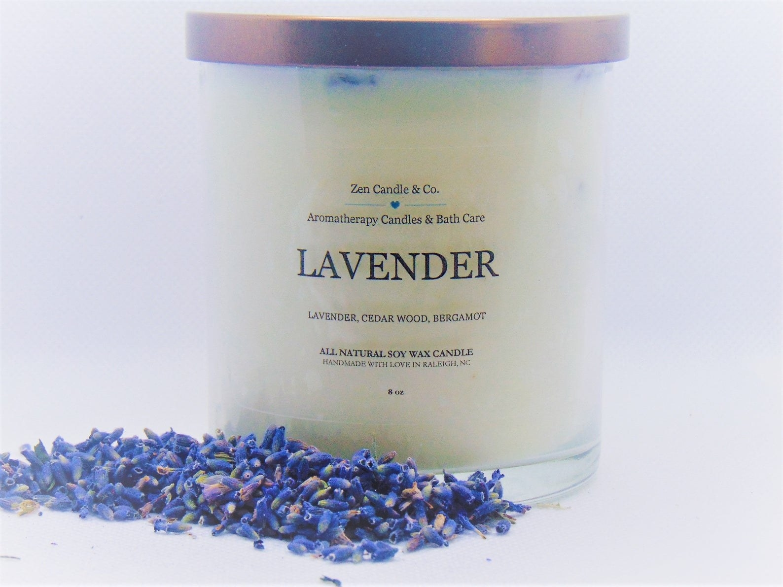 The candle jar with tiny lavender petals next to it