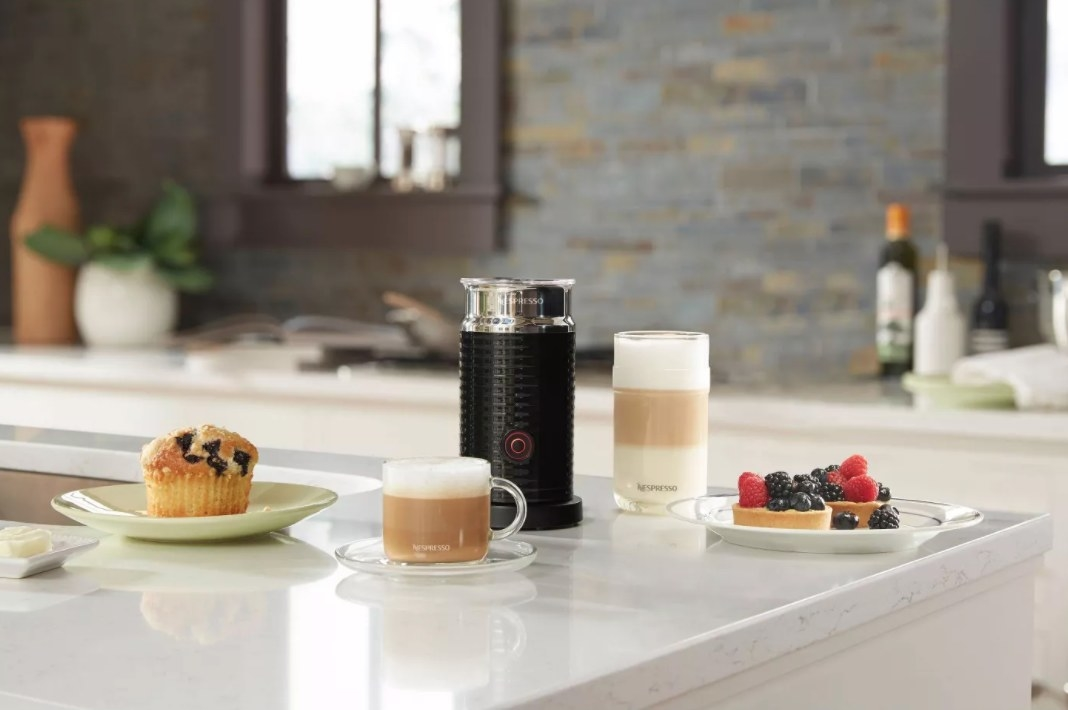 The Nespresso milk frother being used to make coffee drinks with breakfast
