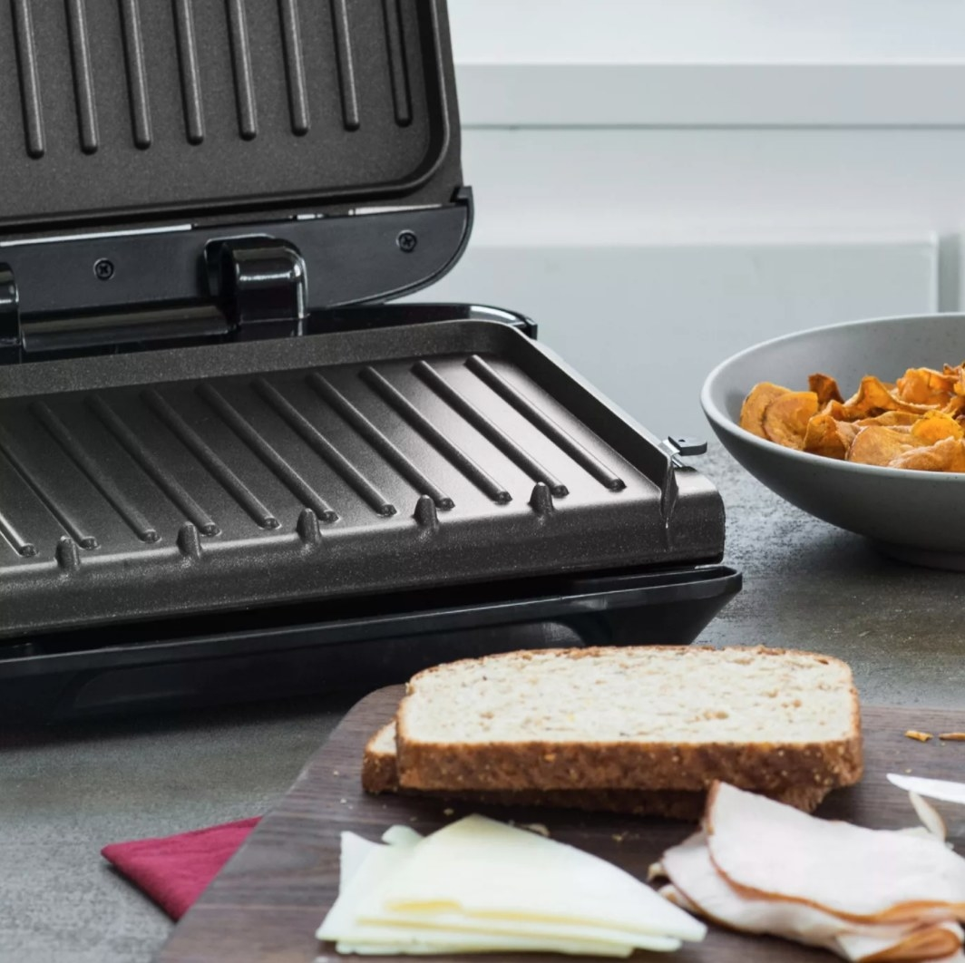 The panini press being used to make a sandwich