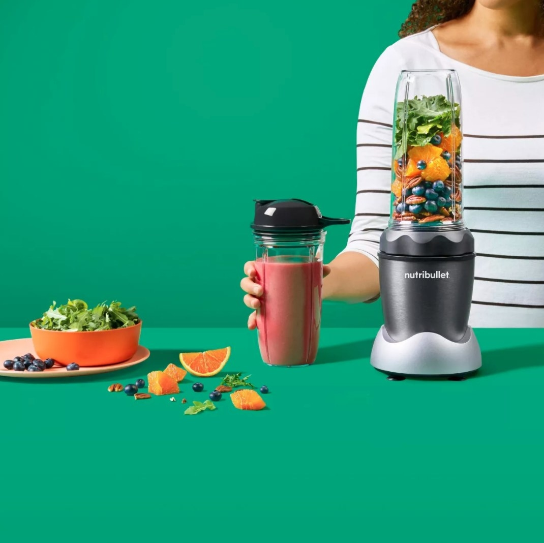 The NutriBullet being used to make a fruit smoothie