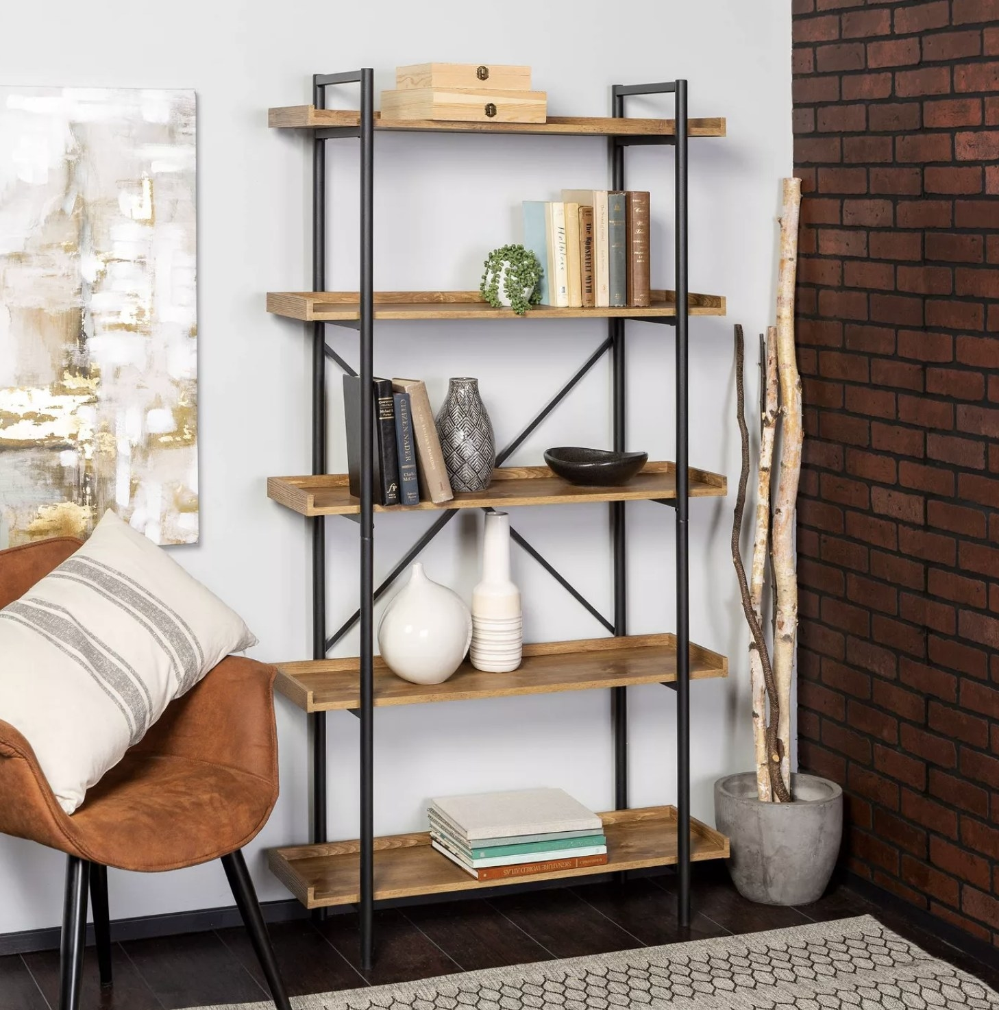 A light wood bookshelf with tray shelves and piping