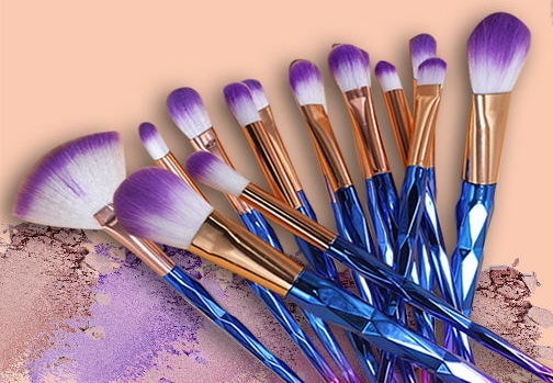 A set of makeup brushes with purple tips