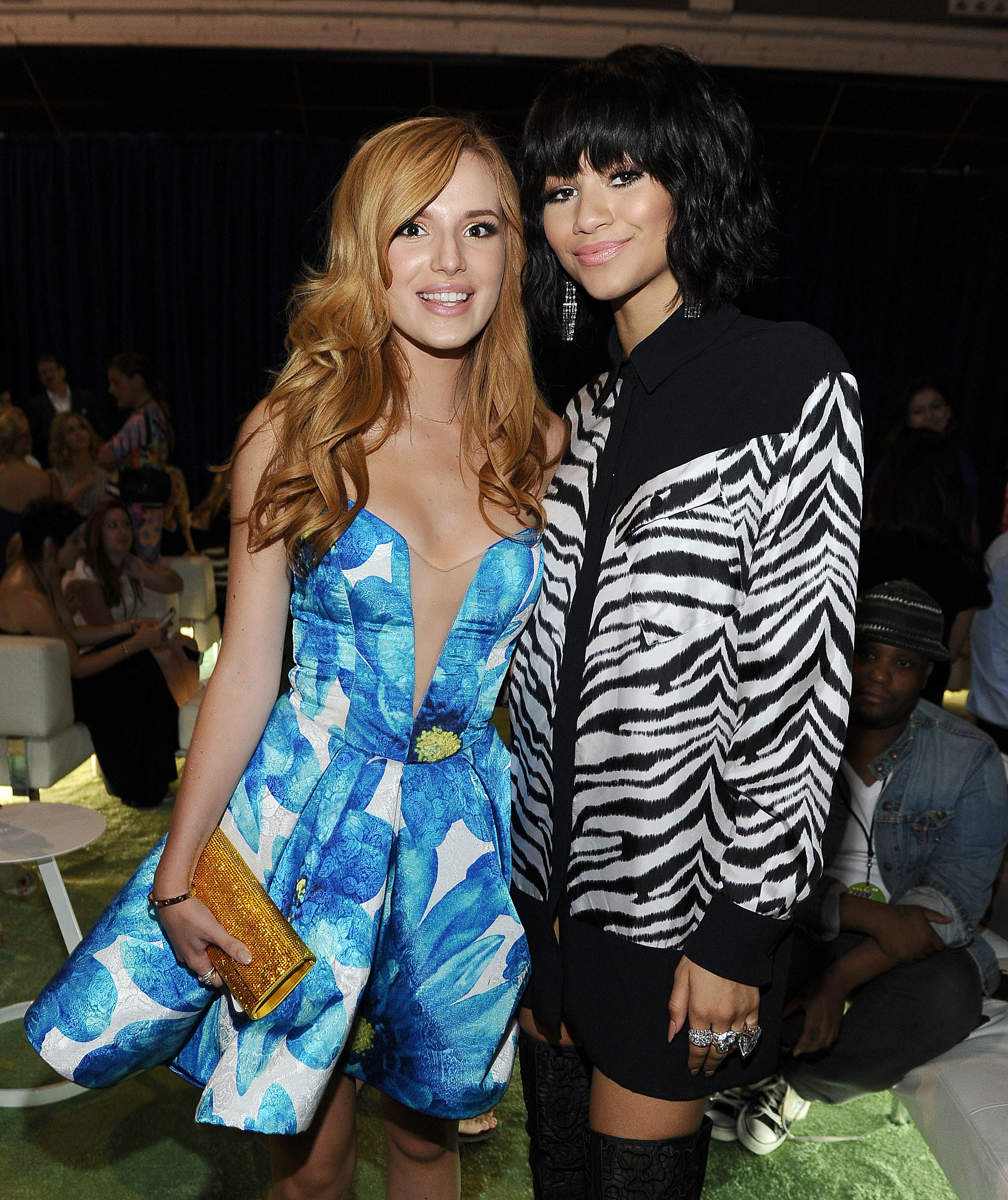 Actresses Bella Thorne and Zendaya Coleman pose in the green room at the 2014 Teen Choice Awards