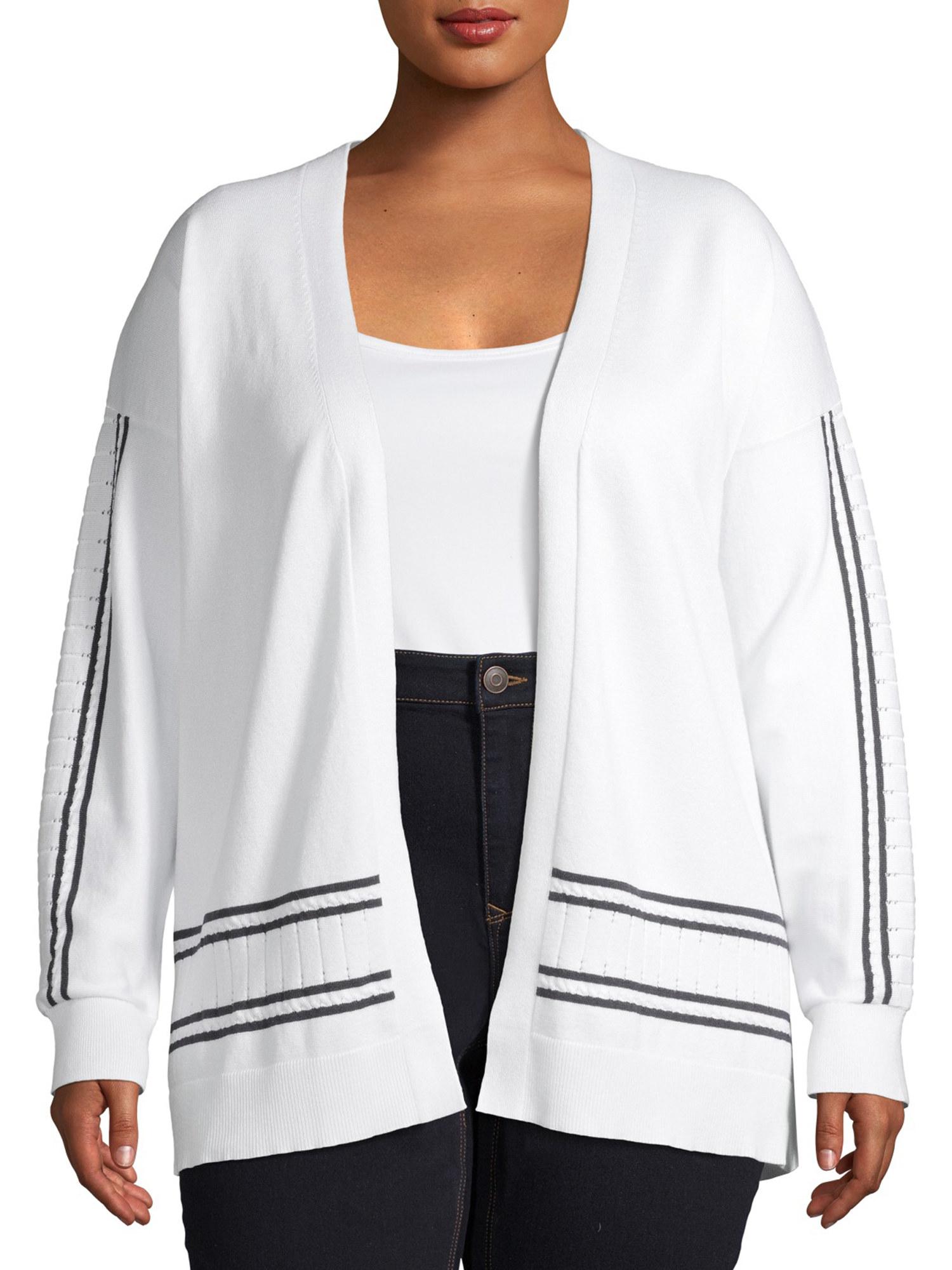 Model wearing the white/navy cardigan
