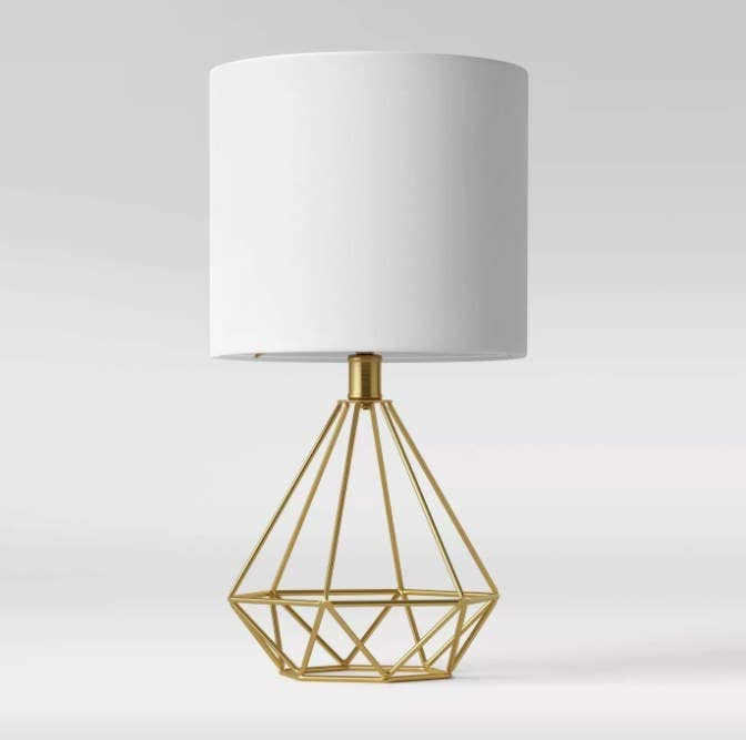 The 3D diamond lamp with a round white shade and metal base