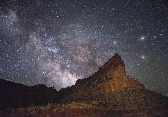 Eph Hanks Tower with the glittering Milky Way in the sky, just before dawn