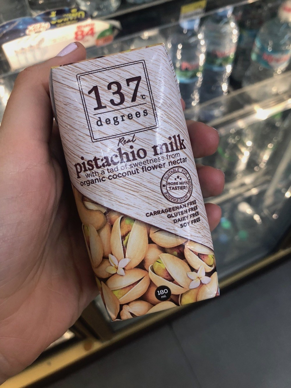 A small carton of milk made from pistachios