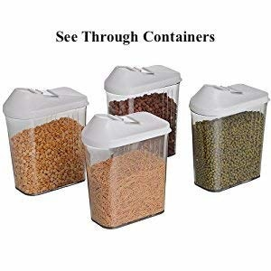 Four see-through containers with cereals and pulses in them.