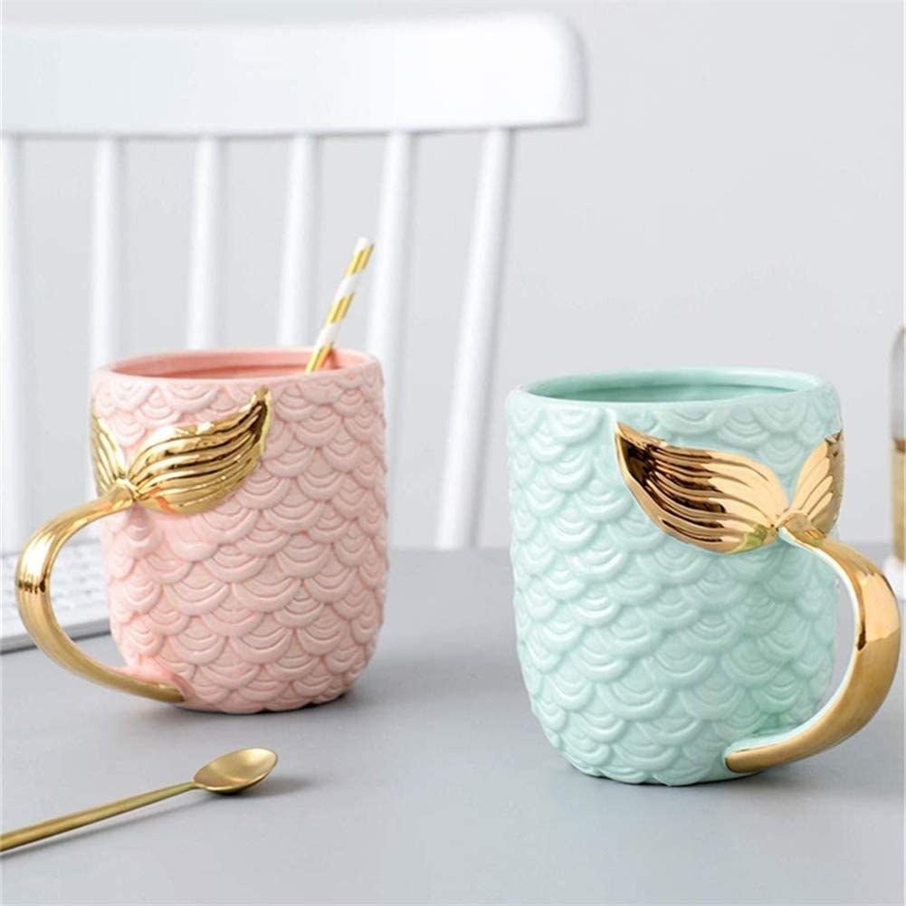 A mug with scales and a gold tail for a handle