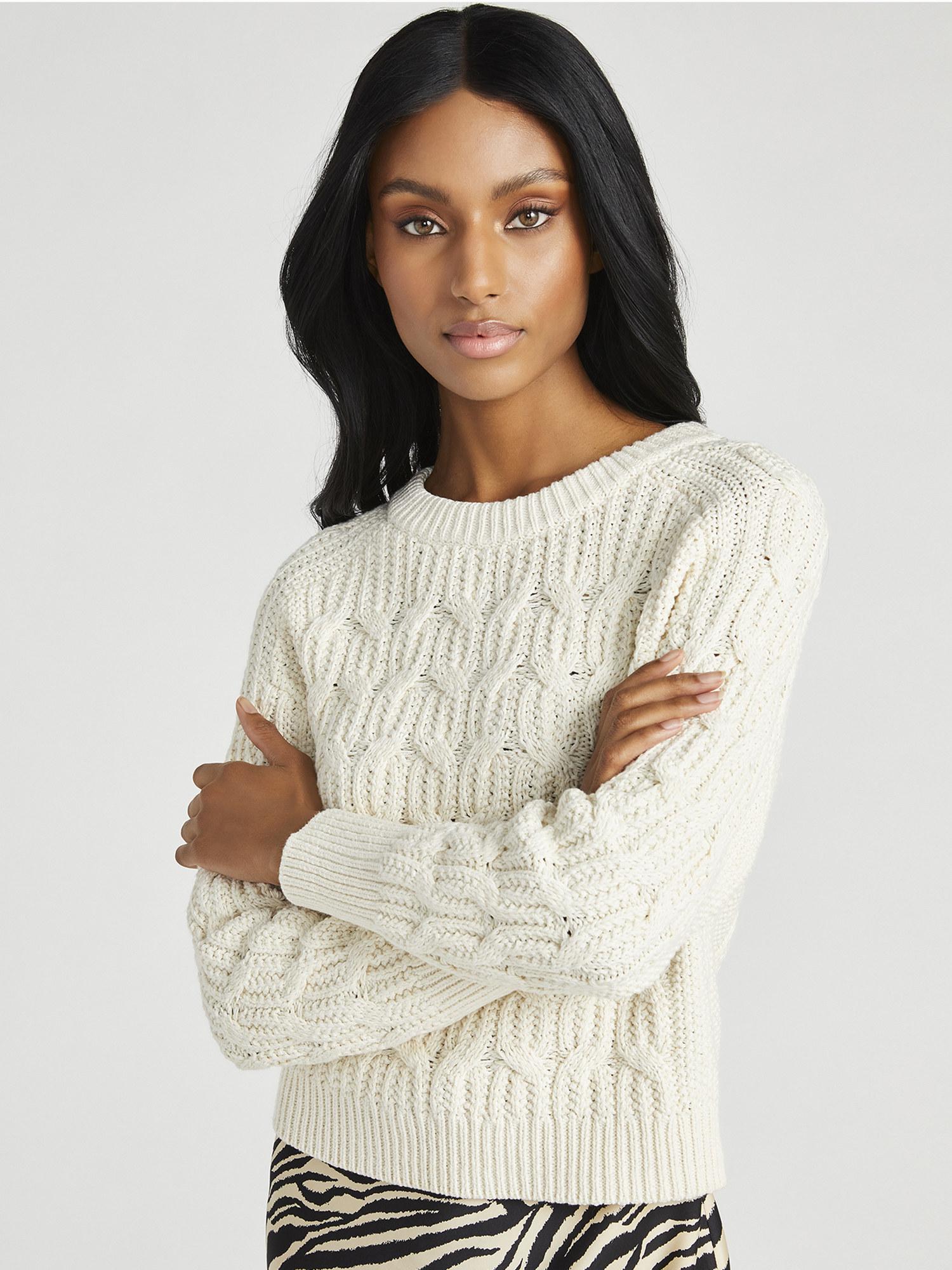 Model wears ivory sweater