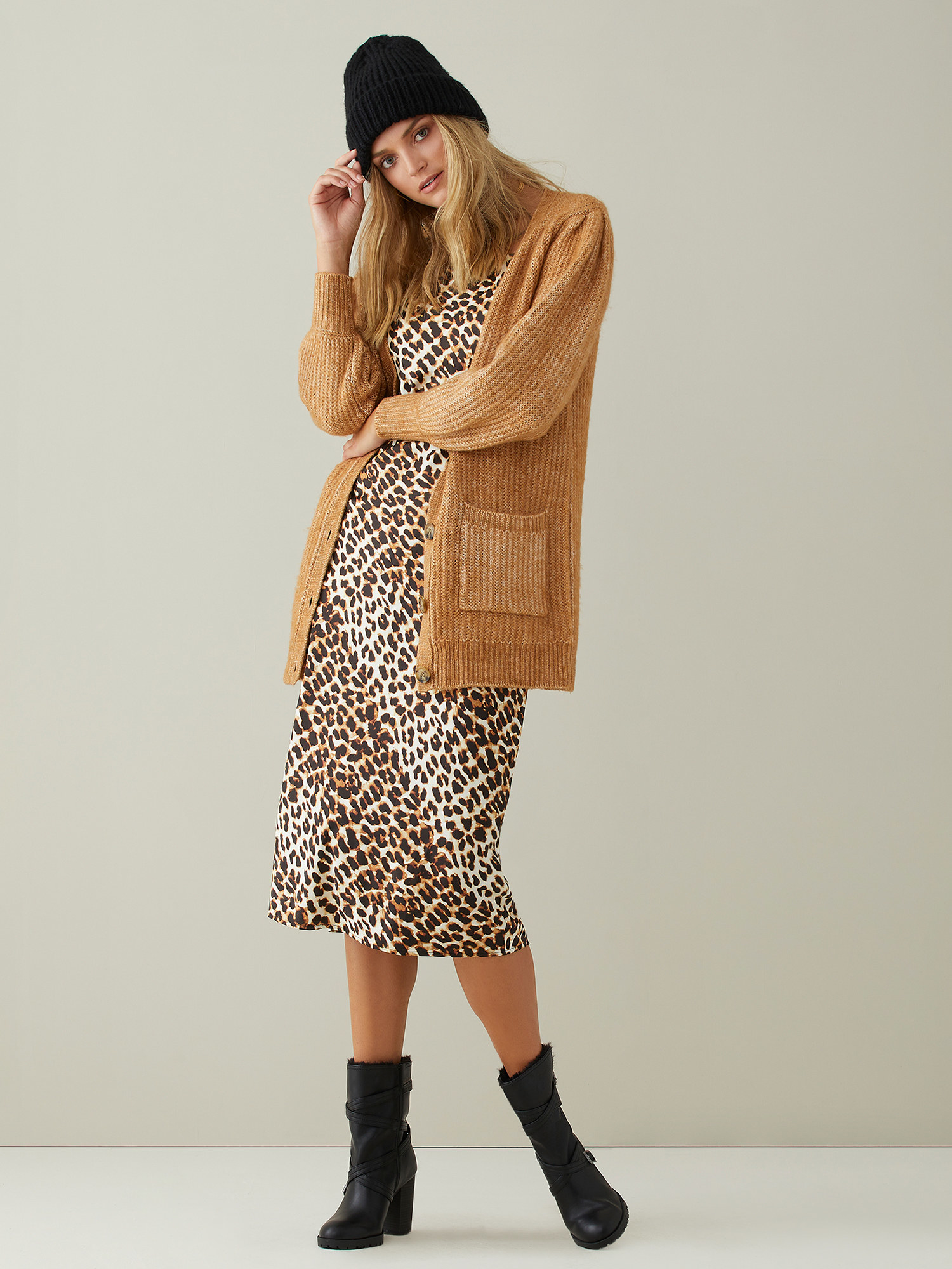 Model wears puff sleeve cardigan in taupe