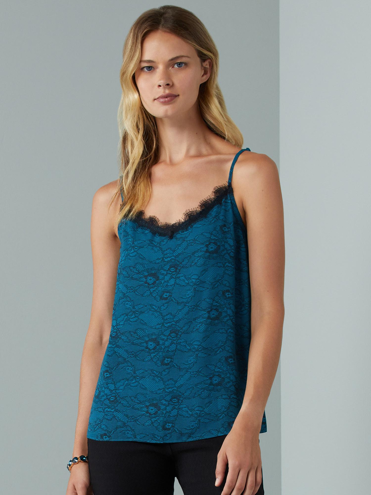 Model wears print cami in lagoon