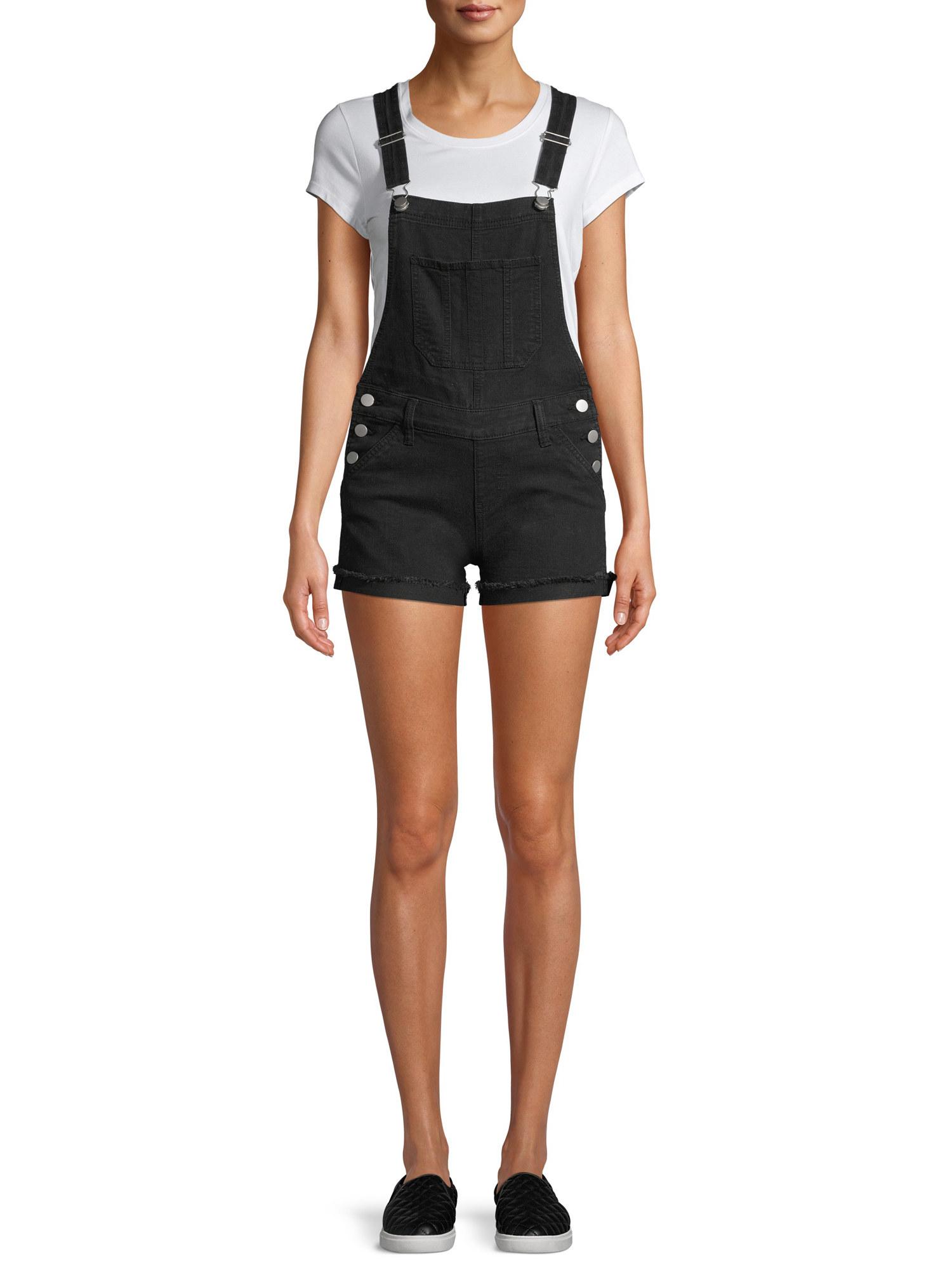 Model wears short overalls in black