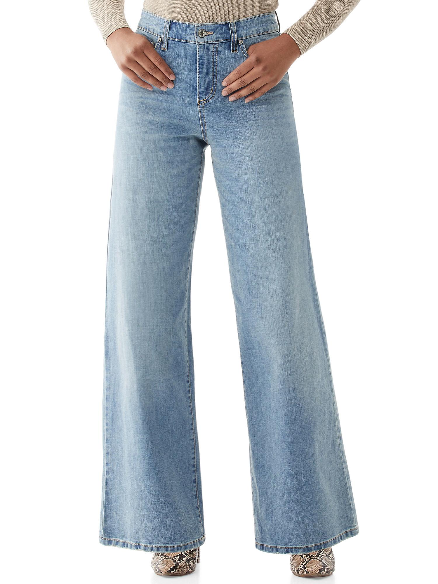 Model wears super wide leg jeans