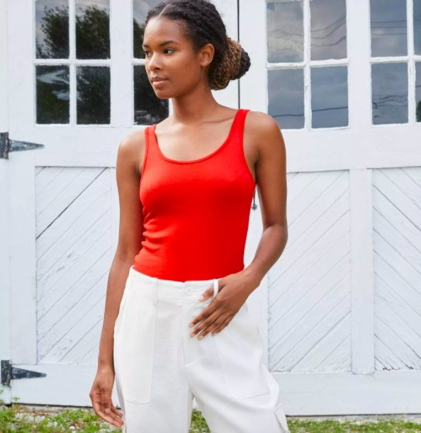Model wearing the red tank top