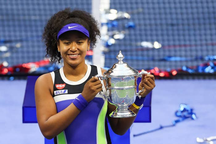 Naomi holding her third Grand Slam trophy at the US Open
