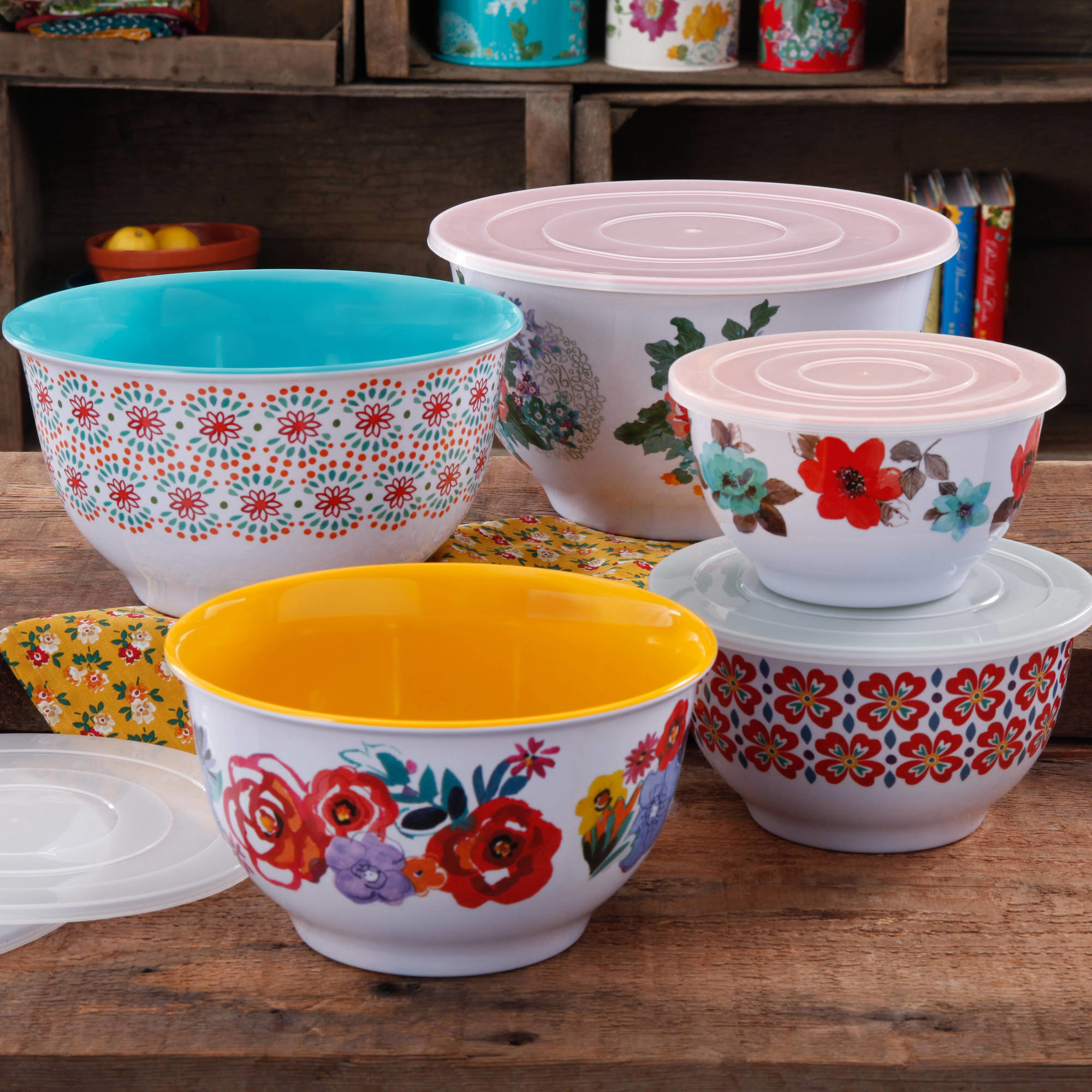 Colorful bowls with floral designs, including matching lids
