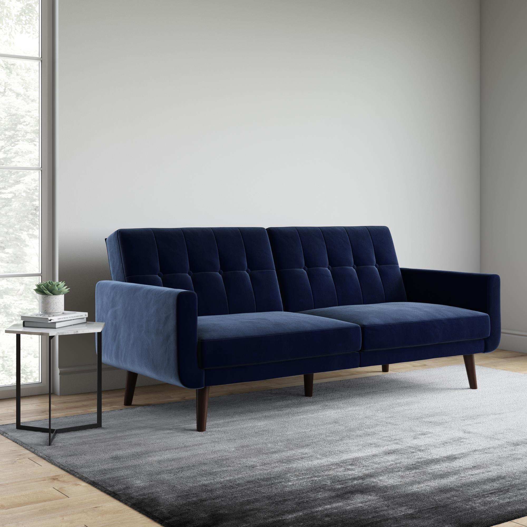 Blue velvet futon with dark wood legs