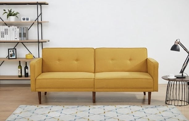 Yellow mid-century modern sofa with wooden legs