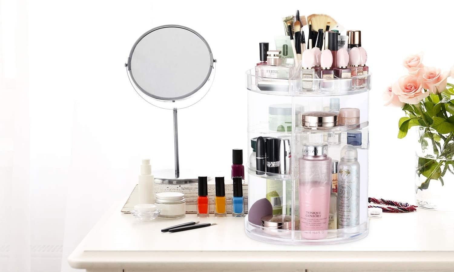 A makeup caddy that rotates and is filled with makeup