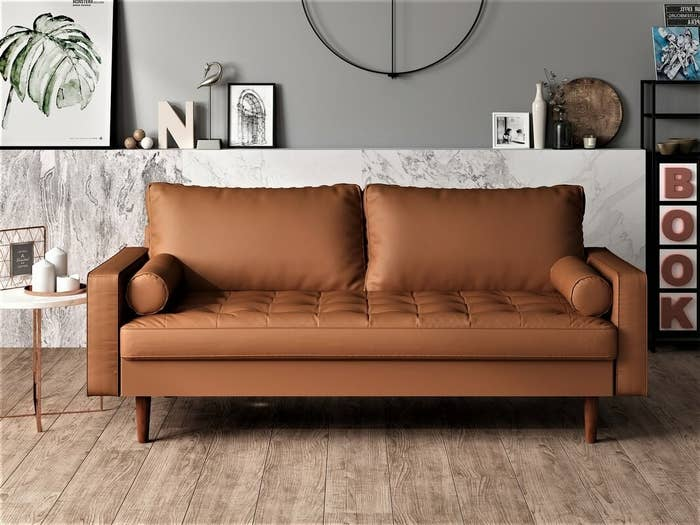 Brown faux-leather sofa with matching wooden legs